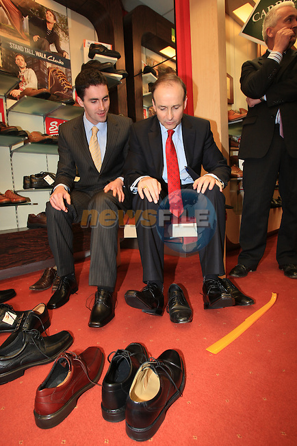 Micheal Martin TD on the campaign trail with Louth canidates James Carroll and Declan Breathnach. Checking out the wholes in the soles of there shoes..Picture: Fran Caffrey / www.newsfile.ie.