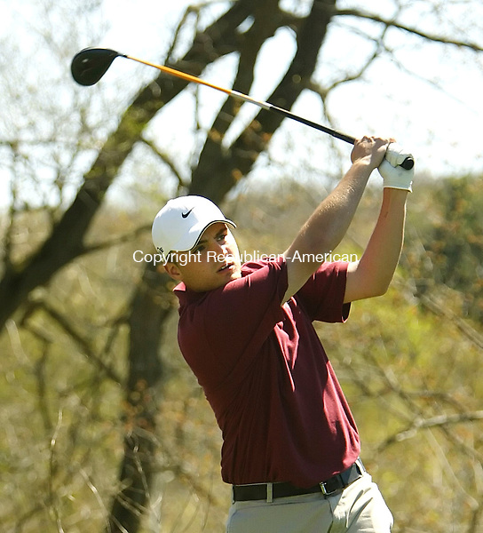 NAUGATUCK, CT 5/03/07- 050307BZ06- Naugatuck's Chris Marques watches his drive on the second tee  during a match against Watertown at Hop Brook Golf Course in Naugatuck Thursday.<br /> Jamison C. Bazinet Republican-American