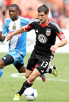 D.C. United forward Chris Pontius (13) shields the ball from Philadelphia Union midfielder Michael Lahoud (13) D.C. United tied The Philadelphia Union 1-1 at RFK Stadium, Saturday August 19, 2012.