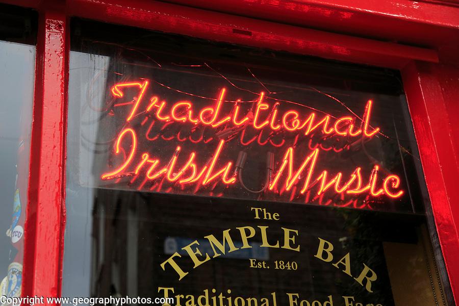 Neon sign for Traditional Irish Music in window of the Temple Bar pub, Dublin city centre, Ireland, Republic of Ireland
