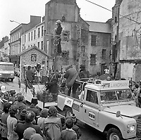 The St. Patrick's Day Parade makes its way down High Street and onto Main Street in 1978. Photo shows the ESB float dressed as an RTE crew electryfying the Black Valley..Picture by Don MacMonagle .www.macmonagle.com