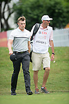 Oliver Fisher of England and his caddie walk during Hong Kong Open golf tournament at the Fanling golf course on 25 October 2015 in Hong Kong, China. Photo by Aitor Alcade / Power Sport Images