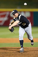 Blake Mascarello (13) of the Purdue Boilermakers delivers a pitch during a game against the Missouri State Bears at Hammons Field on March 13, 2012 in Springfield, Missouri. (David Welker / Four Seam Images).