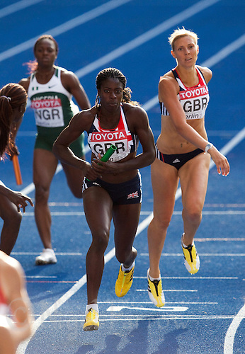 23 AUG 2009 - BERLIN, GER - Christine Ohuruogu (GBR) takes the baton from Lee McConnell (GBR) during the Womens 4 x 400m Relay Final at the World Athletics Championships .(PHOTO (C) NIGEL FARROW)