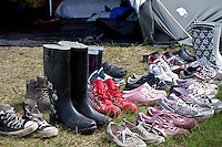 Some patrols have placed their shoes outside of their tents to dry from the last days heavy rains. Photo: Kim Rask/Scouterna