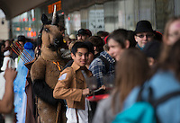 "140927-JRE-7981E-0100<br /> ""Aayrick,"" a furry unicorn, waits in line for Senshi-Con Saturday morning at the Egan Center. Photo by James R. Evans"