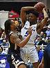 Eli Pemberton #5 of Hofstra University, right, gets pressured by K.J. Scott of Mt. St. Mary's during the first half of non-conference NCAA men's basketball game at Mack Sports Complex in Hempstead, NY on Friday, Nov. 9, 2018