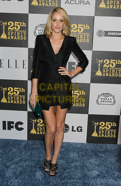 MONET MAZUR.25th Annual Film Independent Spirit Awards - Arrivals held at the Nokia Event Deck at L.A. Live, Los Angeles, California, USA, 5th March 2010..indie full length black dress hand on hip shoulder pads green clutch bag.CAP/ADM/MJ.©Michael Jade/AdMedia/Capital Pictures.