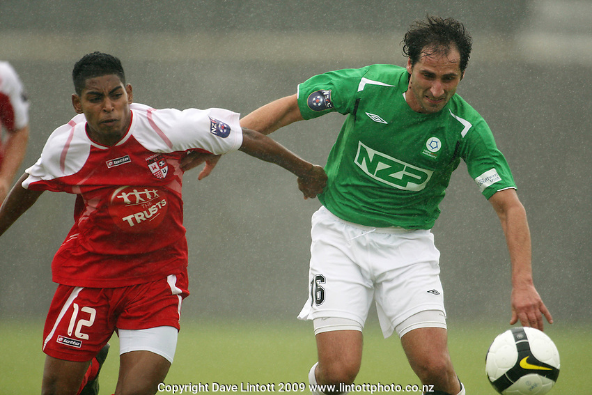 Roy Krishna and Raff De Grigorio chase the ball..NZFC Championship soccer - Youngheart Manawatu v Waitakere United at Memorial Park, Palmerston North. Sunday, 15 November 2009. Photo: Dave Lintott/lintottphoto.co.nz