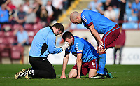 Scunthorpe United's Murray Wallace receives treatment for a facial injury <br /> <br /> Photographer Chris Vaughan/CameraSport<br /> <br /> The EFL Sky Bet League One - Scunthorpe United v Bolton Wanderers - Saturday 8th April 2017 - Glanford Park - Scunthorpe<br /> <br /> World Copyright &copy; 2017 CameraSport. All rights reserved. 43 Linden Ave. Countesthorpe. Leicester. England. LE8 5PG - Tel: +44 (0) 116 277 4147 - admin@camerasport.com - www.camerasport.com