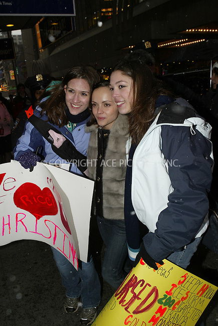 WWW.ACEPIXS.COM . . . . .  ....NEW YORK, FEBRUARY 24, 2005....Christina Ricci arrives for an appearance on MTV's TRL and takes a moment to pose for pictures and sign autographs for fans braving the snow.....Please byline: Ian Wingfield - ACE PICTURES..... *** ***..Ace Pictures, Inc:  ..Philip Vaughan (646) 769-0430..e-mail: info@acepixs.com..web: http://www.acepixs.com