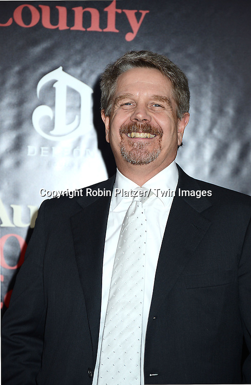 """director John Wells attends the New York Premiere of """"August: Osage County"""" on December 12, 2013 at the Ziegfeld Theatre in New York City."""