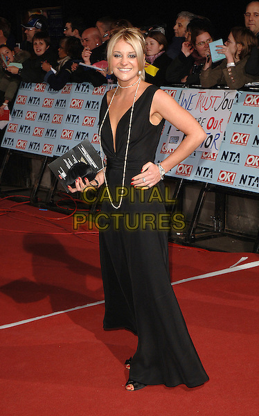 NICOLA STAPLETON.The National Television Awards 2006, Royal Albert Hall, London, UK. .October 31st, 2006.full length black dress necklace clutch purse hand on hip.CAP/BEL.©Belcher/Capital Pictures