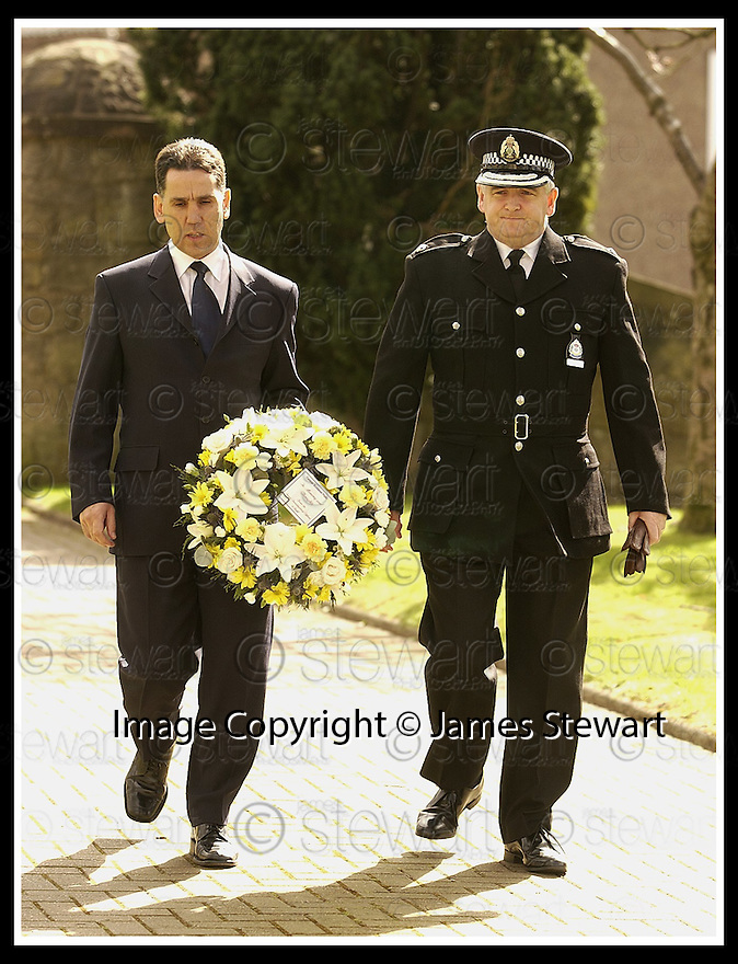 12/04/2002                 Collect Pic : James Stewart .Ref :     .File Name : stewart-linn memorial 01.DCI ALLAN MOFFAT AND SUPERINTENDANT HECTOR CAIRNS OF CENTRAL SCOTLAND POLICE ARRIVE AT THE MEMORIAL SERVICE FOR GARY LINN AT KILSYTH PARISH CHURCH............(see copy from Jim Davis).....James Stewart Photo Agency, 19 Carronlea Drive, Falkirk. FK2 8DN      Vat Reg No. 607 6932 25.Office     : +44 (0)1324 570906     .Mobile  : +44 (0)7721 416997.Fax         :  +44 (0)1324 570906.E-mail  :  jim@jspa.co.uk.If you require further information then contact Jim Stewart on any of the numbers above.........