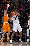 Doral Moore (4) of the Wake Forest Demon Deacons grabs a rebound in front of John Fulkerson (10) of the Tennessee Volunteers during first half action at the LJVM Coliseum on December 23, 2017 in Winston-Salem, North Carolina.  The Volunteers defeated the Demon Deacons 79-60.  (Brian Westerholt/Sports On Film)