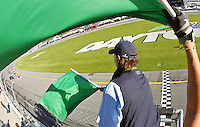 The green flag waves to start the Rolex 24 at Daytona , Daytona International Speedway, Daytona Beach, FL, January 2009.  )Photo by Brian Cleary)