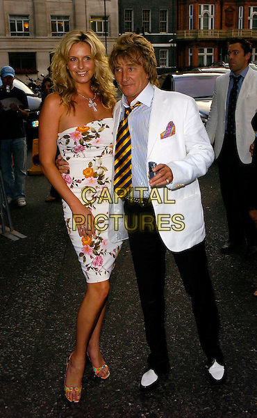 PENNY LANCASTER & ROD STEWART.The BSQUAREB Summer Ball, Berkeley Square, London, UK..Berkeley Square Ball.July 6th, 2006.Ref: CAN.full length white floral print strapless dress black trousers suit jacket couple striped stripes tie.www.capitalpictures.com.sales@capitalpictures.com.©Capital Pictures