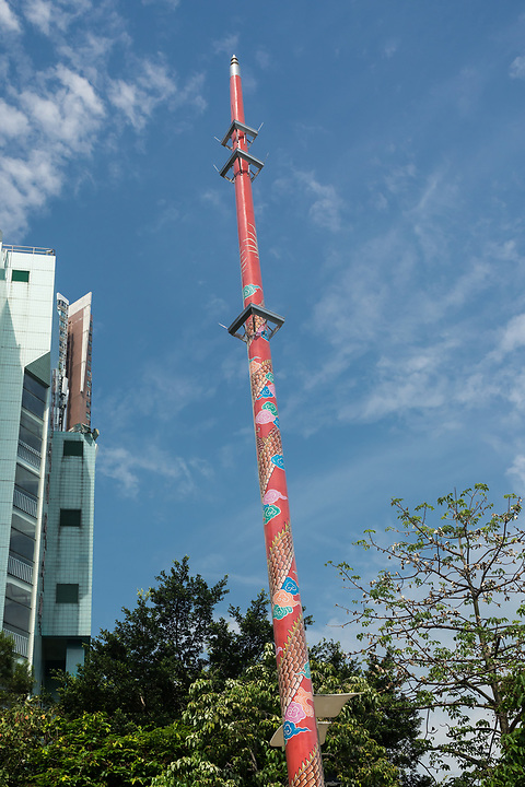 """One of two colourful Feng Shui """"Dragon"""" timber poles set in the forecourt of the Hung Shing Temple."""