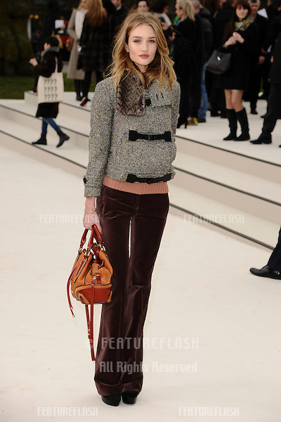 Rosie Huntington Whiteley arriving for the Burberry Prorsum fashion show as part of London Fashion Week 2012 A/W in Kensington Gardens, London. 20/02/2012 Picture by: Steve Vas / Featureflash.