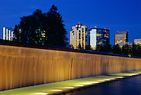 Downtown Bellevue's skyline set above a lighted waterfall in in Bellevue Downtown Park. Bellevue WA.