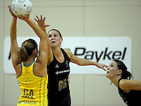 NZ's Casey Williams and Anna Scarlett mark Sharelle McMahon. International Netball  - New Zealand Silver Ferns v Australian Diamonds Constellation Cup match at TSB Bank Arena, Wellington on Thursday, 2 September 2010. Photo: Dave Lintott/lintottphoto.co.nz.
