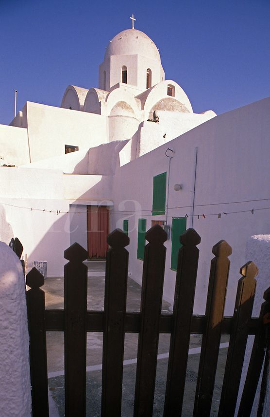 The back courtyard and gate of the main church in Messaria. Santorini, Greece.