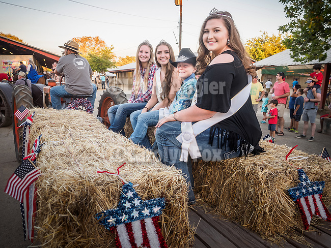 Miss Amador Trinity Kaschner and her court ride in the tractor parade. <br /> <br /> Saturday, Day 3 of the 79th Amador County Fair, Plymouth, Calif.<br /> <br /> Local cowboy ranch rodeo, livestock beauty pageant, youth tractor rodeo, Mutton Bustin' finals<br /> <br /> <br /> #AmadorCountyFair, #PlymouthCalifornia,<br /> #TourAmador, #VisitAmador