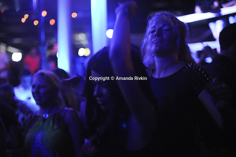 Clubgoers at Bard, a nightclub on a splav or barge on the Danube River, dance to fast-paced turbofolk hits by Dara Bubamara on the main dance floor of the club in Belgrade, Serbia on July 8, 2015.  Dara Bubamara's career extends back to 1989 when she got her start on television singing songs by Lepa Brena.