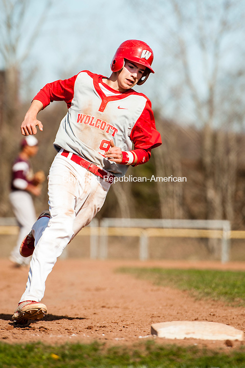 WOLCOTT, CT-28 April 2014-042814EC04-  Wolcott's Robert Parazella heads to third. Sacred Heart defeated the Eagles 7-5 in Wolcott Monday afternoon. Erin Covey Republican-American