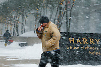 A man makes his way under the snow during the pass of the winter storm JONAS, in New York, 01/23/2016. Photo by VIEWpress