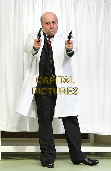 Omid Djalili.'What The Butler Saw' at the Vaudeville Theatre, The Strand, London, England..May 9th 2012.stage full length black pinstripe suit white coat guns.CAP/ROS.©Steve Ross/Capital Pictures