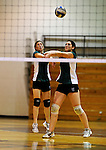 14 November 2010: Vermont Commons School Juniors, and team co-captains Lex Jackson (left) and Leslie Gadway in action during the 2010 Vermont State Volleyball Championships at Saint Michael's College in Colchester, Vermont. Participating schools included: the Enosburg Falls Hornets, the Lake Region Union Rangers, the Lyndon Institute Vikings, and the VCS Flying Turtles. The Girls Championship went to Vermont Commons School for the third consecutive year, while the Boys Championship went to Lake Region Union High School for the first time. Mandatory Credit: Ed Wolfstein Photo.