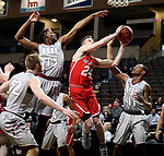 SIOUX FALLS, SD - MARCH 12:  Kyle Mangas #24 from Indiana Wesleyan takes the ball to the basket against Aaron Thomas #13 and Jaylen McKay #11 from IU East during their semifinal game at the 2018 NAIA DII Men's Basketball Championship at the Sanford Pentagon in Sioux Falls. (Photo by Dave Eggen/Inertia)