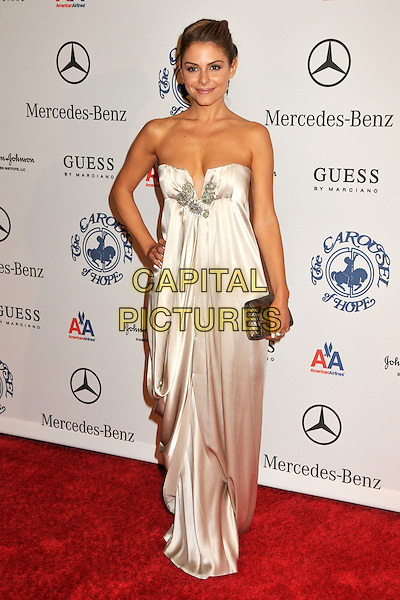 MARIA MENOUNOS .The 30th Annual Carousel Of Hope Ball at the Beverly Hilton Hotel, Beverly Hills, California, USA..October 25th, 2008.full length white strapless dress long maxi silver clutch bag hand on hip .CAP/ADM/BP.©Byron Purvis/AdMedia/Capital Pictures.