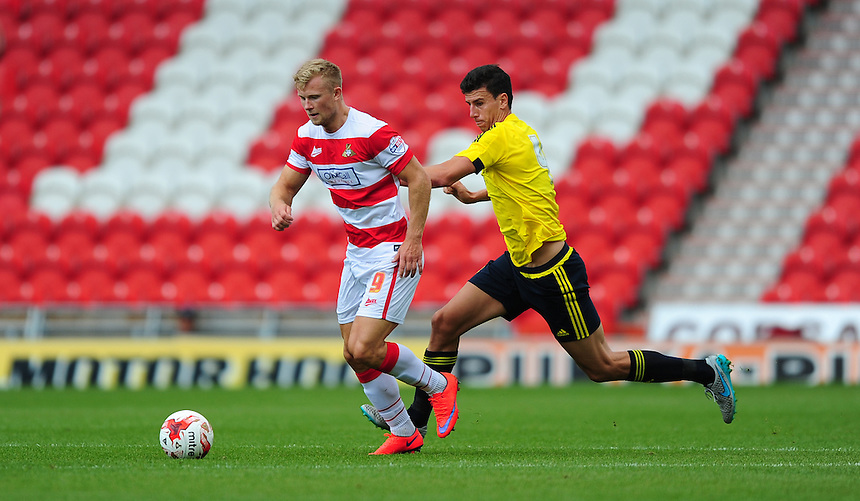 Doncaster Rovers' Curtis Main shields the ball from Middlesbrough's Daniel Ayala<br /> <br /> Photographer Chris Vaughan/CameraSport<br /> <br /> Football - Pre-Season Friendly - Doncaster Rovers v Middlesbrough - Saturday 25th July 2015 - Keepmoat Stadium, Doncaster<br /> <br /> &copy; CameraSport - 43 Linden Ave. Countesthorpe. Leicester. England. LE8 5PG - Tel: +44 (0) 116 277 4147 - admin@camerasport.com - www.camerasport.com