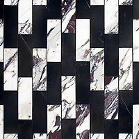 Ziggurat Grand, a stone hand-cut mosaic, shown in polished Plumeria and Nero Marquina.