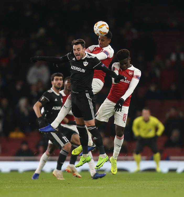 Arsenal's Joe Willock wins a header<br /> <br /> Photographer Rob Newell/CameraSport<br /> <br /> UEFA Europa League Group E - Arsenal v FK Qarabag - Thursday 13th December 2018 - Emirates Stadium - London<br />  <br /> World Copyright © 2018 CameraSport. All rights reserved. 43 Linden Ave. Countesthorpe. Leicester. England. LE8 5PG - Tel: +44 (0) 116 277 4147 - admin@camerasport.com - www.camerasport.com