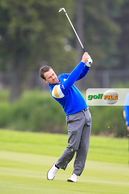 Graeme McDowell (EUR) plays his 2nd shot on the 15th hole during Sunday's Singles Matches of the Ryder Cup 2014 played on the PGA Centenary Course at the Gleneagles Hotel, Auchterarder, Scotland.: Picture Eoin Clarke, www.golffile.ie: 28th September 2014