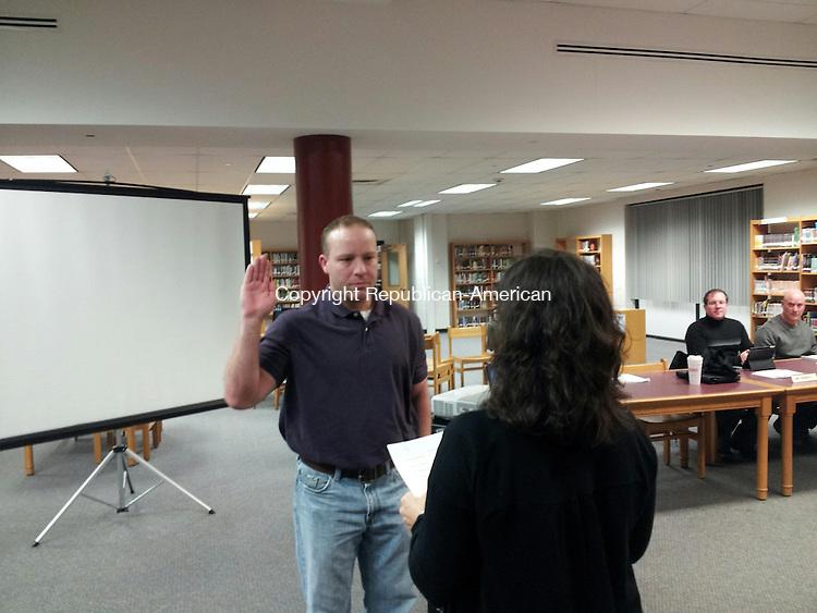 TORRINGTON, CT- 22 January 2014- 012214BJ01-- Jeremy Hinman, the newest member of the Board of Education, is sworn in by Ellen Hoehne, secretary for the Board of Education. Bruno Matarazzo Jr. Republican-American