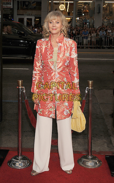 """BLYTHE DANNER .arriving at the Los Angeles premiere of """"Paul"""" at Grauman's Chinese Theatre in Hollywood, California, USA, March 14th, 2011. .full length orange red peach embroidered floral coat jacket white trousers yellow bag .CAP/ROT/TM.©TM/Roth/Capital Pictures"""