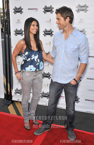 """Roselyn Sanchez & husband Eric Winter at press event to launch """"The Rally for Kids with Cancer Scavenger Cup"""" at The Americana at Brand Shopping Centre, Glendale, California..The rally will be held on May 2nd in Los Angeles and will raise money for Childrens Hospital Los Angeles and Parents Against Cancer..March 31, 2009  Los Angeles, CA.Picture: Paul Smith / Featureflash"""