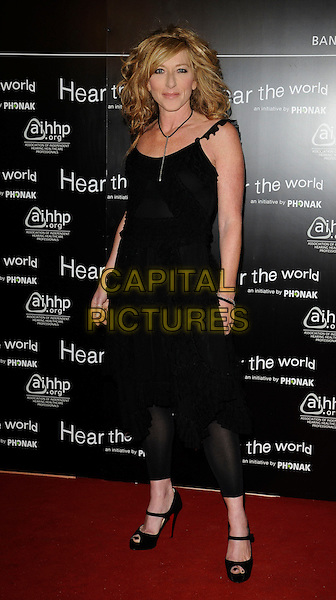 KELLY HOPPEN. 'Hear the Word- An Exhibition of Photography' VIP preview at Duke of York's HQ, Chelsea, London England.21st July 2009.full length black dress leggings.CAP/CAN.©Can Nguyen/Capital Pictures.