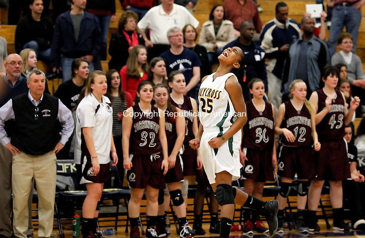 Waterbury, CT-22 February 2012-022212CM12- Holy Cross' Briana Bradford celebrates after defeating Torrington 57-54 at the girls NVL championship game Wednesday night in Waterbury.  Looking on in disbelief is the Torrington girls bench.     Christopher Massa Republican-American
