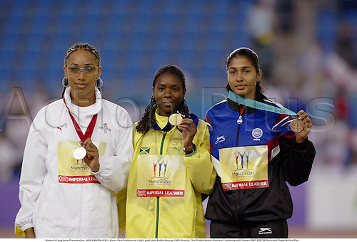 Women's Long Jump Presentation, JADE JOHNSON (ENG), silver, Elva Goulbourne (JAM), gold, Anju Bobby George (IND), bronze, City Of Manchester Stadium, Commonwealth Games 2002, 020729 Photo:Neil Tingle/Action Plus...woman winner .Athlete track and field .athletics podium medals.female.jumper