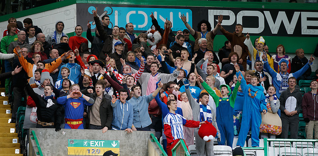 Kilmarnock fans in fancy dress celebrate a 2-0 victory at Celtic Park