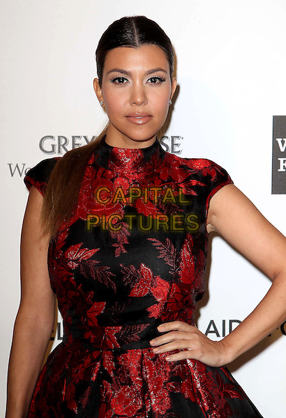 Kourtney Kardashian.The 21st Annual Elton John AIDS Foundation Academy Awards Viewing Party held at The City of West Hollywood Park in West Hollywood, California, USA..February 24th, 2013.oscars half length dress hand on hip red black embroidered floral print .CAP/ADM/KB.©Kevan Brooks/AdMedia/Capital Pictures.
