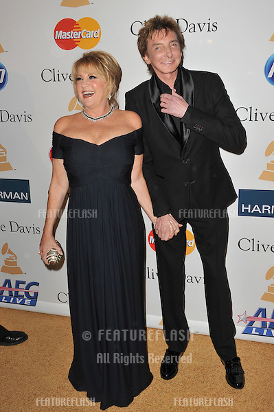 Barry Manilow & Lorna Luft at the 2011 Clive Davis pre-Grammy party at the Beverly Hilton Hotel..February 12, 2011  Beverly Hills, CA.Picture: Paul Smith / Featureflash