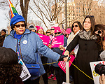 February 11, 2017. Raleigh, North Carolina.<br /> <br /> Lee Byam, left, holds hands with Jennifer Zelman as the HKONJ pre-march speakers rally the crowd. <br /> <br /> Thousands gathered in downtown Raleigh for the annual HKONJ People's Assembly, a civil rights march tied to the Moral Monday movement. Supporters from around the state gathered to march and speak out against nationwide attacks on civil rights and the Trump administration.<br /> <br /> Jeremy M. Lange for The New York Times