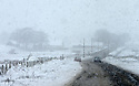 An abandon car is seen on the side of a road, as motorists battle snow flurries near Dundrod, County Antrim, Friday, December 8th, 2017. Photo/Paul McErlane