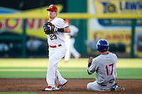 Ryan Jackson (23) of the Springfield Cardinals turns a double play during a game against the Midland RockHounds at Hammons Field on July 11, 2011 in Springfield, Missouri. (David Welker / Four Seam Images)